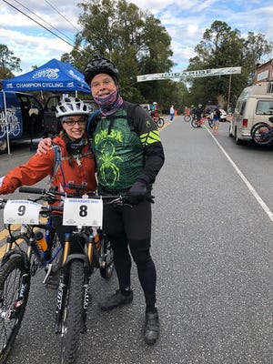 Mike Stephens and his daughter ride together.  [Submitted]