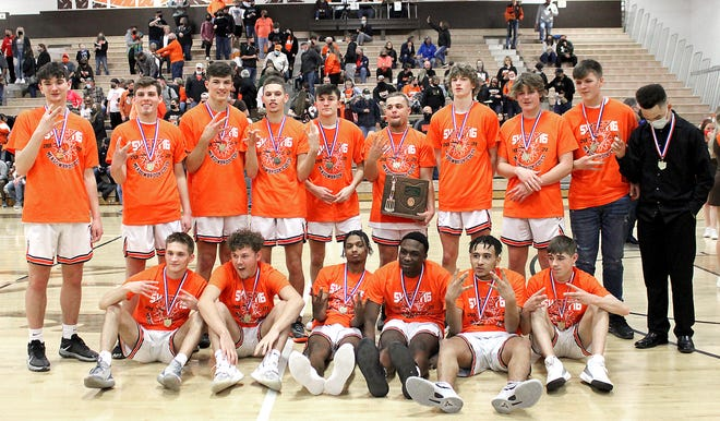 Members of the Meadowbrook High School basketball team show off their hardware after upending Guernsey County rival Cambridge in the Division II district championship game.
