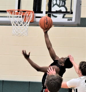 A solid performance by Isaac Slabaugh, seen here soaring and scoring against Malvern, helped Hiland advance to the Div. IV Regional finals for the fifth straight season.