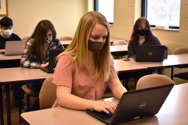 Morgan Andrews, a second-year student at the Jackson College/Lenawee Intermediate School District Academy, is pictured in class. The academy is a middle college program that allows students to earn a high school diploma and an associate degree in five years. This year marks 10 years since the academy opened.