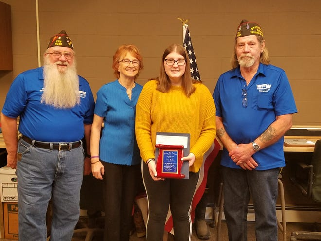 Erin Mehan, an eighth grader at Springbrook Middle School in Adrian, second from right, was named this year's Patriots Pen essay scholarship program winner. She is pictured, from left, with District 6 VFW Commander Reinhold Yanka; Sue Huetter, the VFW Auxiliary No. 1584 scholarship chairwoman; and Department of Michigan VFW Commander Scott Gloger.