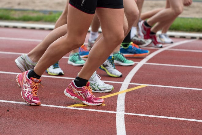 Track and field runners stock image.