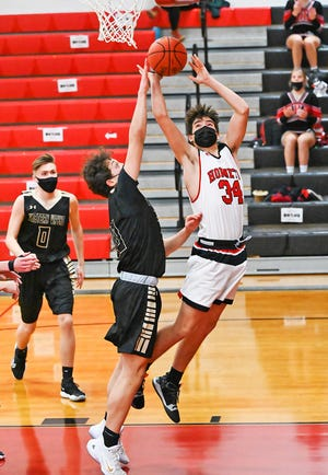 Honesdale's Austin Borsdam (34) powers his way to a basket during Lackawanna League hoops action. The Hornets closed out their 2021 season with a tough loss to Dallas in the District Two playoffs.