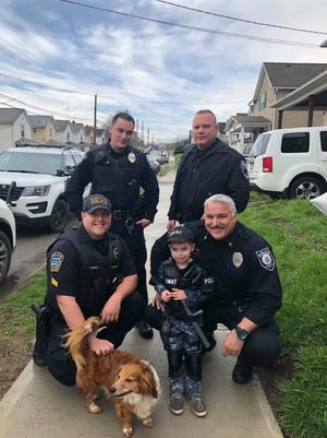 When parents of Miles Cucunato of Ellwood City asked if a police officer could attend his 4th birthday in April 2019 they were surprised to have four officers from three local departments show up. Pictured are, left to right, Franklin Township Police Cpl. Josh Shimko, Ellwood City Police Officer Richie Kruger, North Sewickley Township Police Officer Billy Daufen, Ellwood City Police Officer Rob Magnifico and Cucunato.