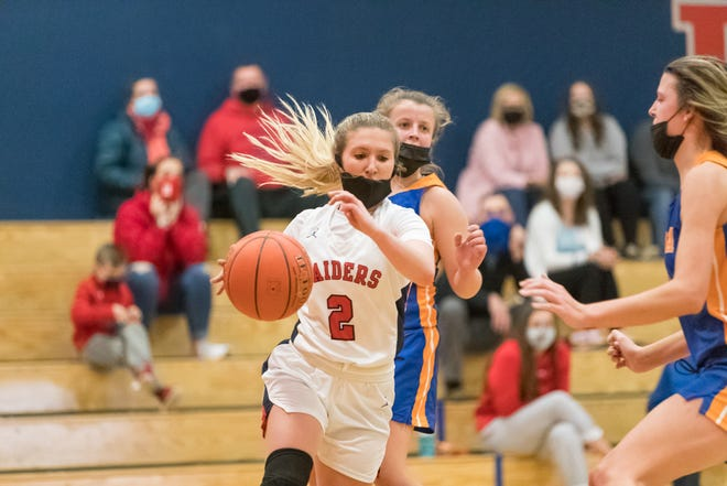 Hornell's Jaden Sciotti (2) weaves between a pair of defenders on Tuesday evening.