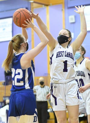 West Canada Valley Indian Hanna Burdick (1) tries to block or alter a shot by Dolgeville Blue Devil Sydney Bliss during Monday's game.