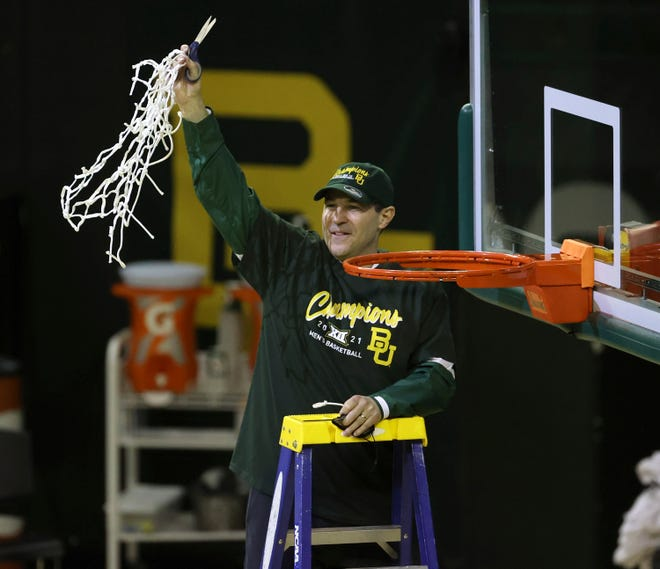 Baylor head coach Scott Drew holds up the netting as they celebrate their Big 12 championship after their game against Texas Tech Sunday. Baylor leads seven ranked teams taking part in the Big 12 Tournament starting Wednesday night at T-Mobile Center in Kansas City.