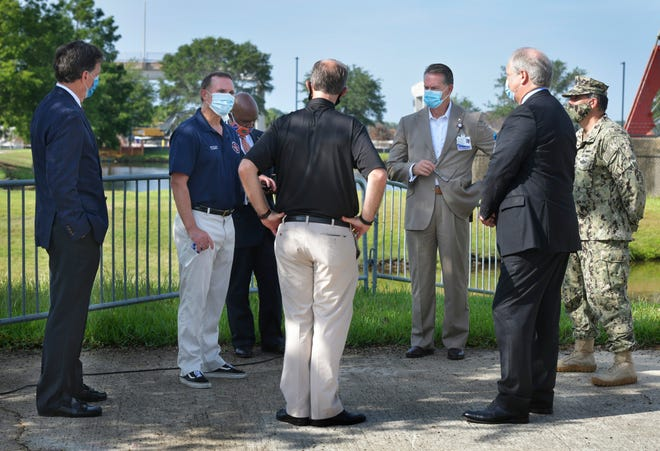Mayor Lenny Curry (second from left) talks with local hospital officials after a news conference about hospital safety amid the coronavirus pandemic in late May .
