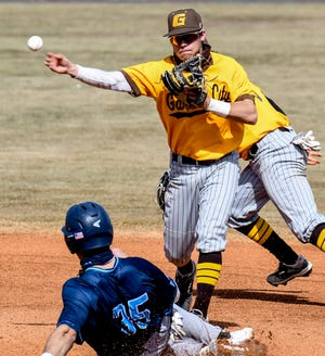 Garden City Community College shortstop Kyle Jameson readies to throw to first base to complete a double play after tagging second base to get Colby's Jake Ticer out in a February game at Williams Stadium.