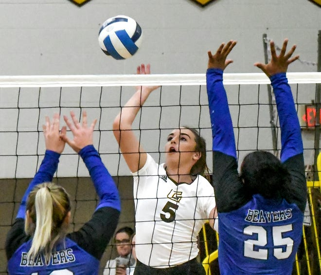Garden City Community College's Alli Meng, center, goes for a kill against Pratt in a match earlier this season at Perryman Athletic Complex.
