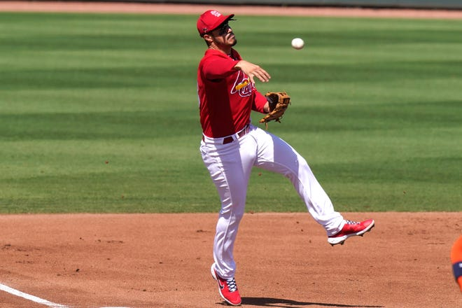 St. Louis Cardinals third baseman Nolan Arenado throws to first where Houston Astros' Yuli Gurriel was out with a groundout during the fourth inning of a spring training game, Sunday, March 7, in Jupiter, Fla.