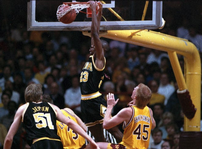 Iowa's Roy Marble dunks against Minnesota during a game on Jan. 14, 1989, in Minneapolis.