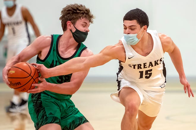 Galesburg junior Alex Egipciaco, right, knocks the ball away from Alleman's Jake Mattecheck for a steal during the Silver Streaks' 60-21 WB6 Conference win over the Pioneers on Tuesday night.