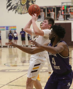 Carson Kieffer puts up a floater during Tuesday's Class 5A quarterfinal against Topeka West.