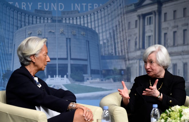 FILE - In this July 2, 2014, file photo International Monetary Fund Managing (IMF) Director Christine Lagarde, left, and now-U.S. Treasury Secretary Janet Yellen sit down for a conversation at the IMF in Washington.
