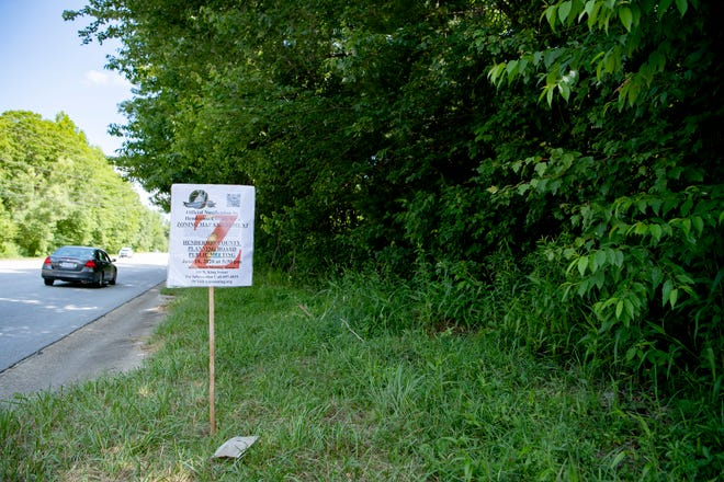 A change in zoning notice for a new SE Asphalt drum plant is posted along the Spartanburg Highway at the proposed site in East Flat Rock on June 12, 2020.