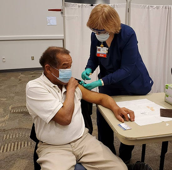 Thomas Allen of Hendersonville receives his COVID-19 vaccine through Pardee UNC Health Care's vaccine clinic at Blue Ridge Community College on Feb. 26.
