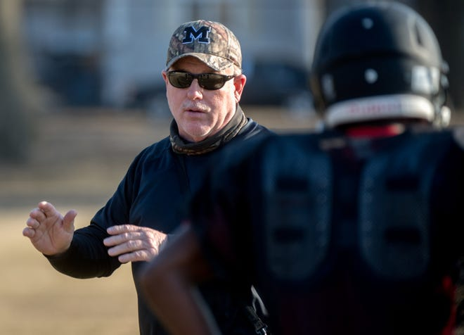 Dan Fauser returns to the sidelines this football season to coach the Manual High School Rams.