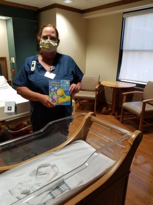 Alpha Mu Chapter of Delta Kappa Gamma women educators have been giving newborns at FHN Memorial Hospital with books. Pictured: Donna Alt.