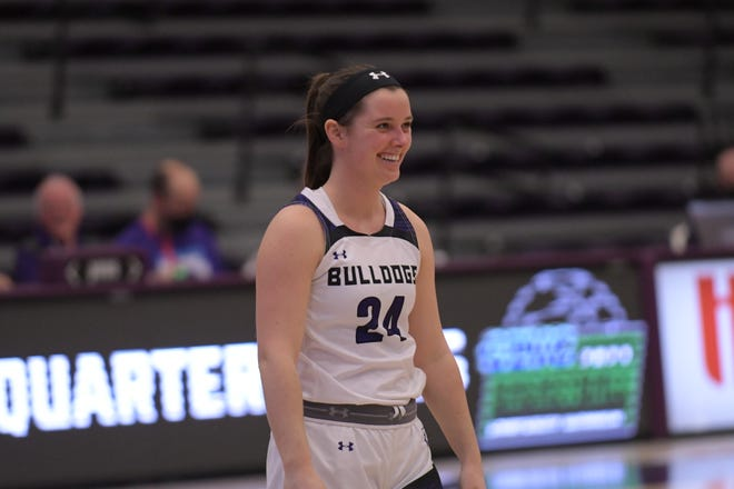 Truman senior point guard Tiffany Davenport smiles during pre-game introductions for the team's GLVC Tournament game against Maryville.