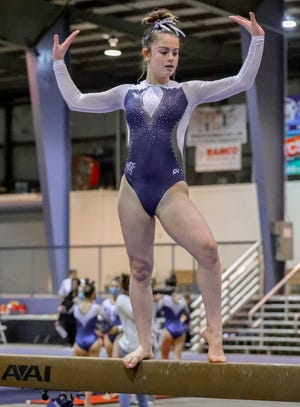 Hudson junior Lydia Redd performs a routine last month. Redd was one of several Hudson gymnasts to make the 2021 state meet. The Explorers finished in fourth place as a team.