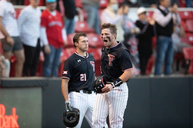 Texas Tech second baseman Jace Jung, right, celebrates a home run during a March 9 game against Gonzaga. Jung is tied for the NCAA Division I lead in home runs with 15 and in runs batted in with 50.