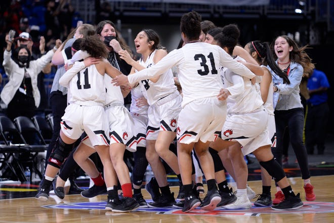 The Brownfield Cubs celebrate after securing a 68-64 overtime win over Fairfield to claim the Class 3A state championship March 10 at the Alamodome in San Antonio.