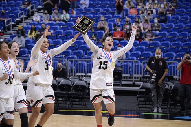 Brownfield's Gabi Fields (15), who was named the MVP of the Class 3A state championship game, celebrates with teammates after the Lady Cubs secured a 68-64 overtime win over Fairfield in the title contest March 10 at the Alamodome in San Antonio.