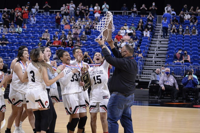The Brownfield girls accept their Class 3A state championship trophy after the Lady Cubs beat Fairfield 68-64 in overtime Wednesday at the Alamodome in San Antonio.