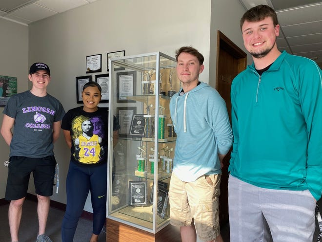Award winners from Lincoln College are, from left: Spencer Davis, Sárah Lee, Zaknafein Luken and Adam Hoffman, standing by the trophies they received from the Intercollegiate Broadcasting System.