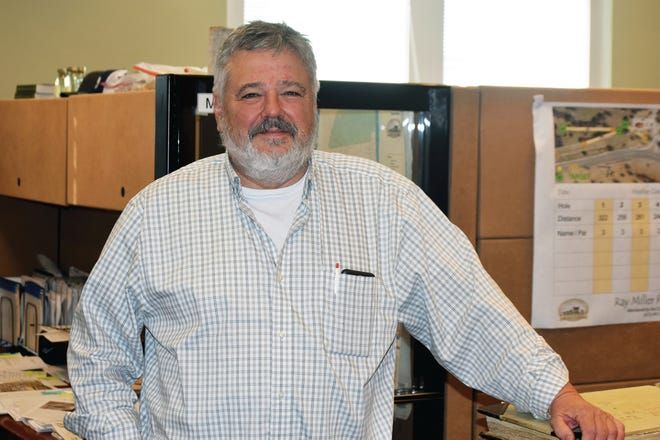 Mike McDonald stands in the Public Works Department at Leavenworth City Hall. McDonald will retire next week from his job as the public works director and city engineer after more than 32 years with the city of Leavenworth.