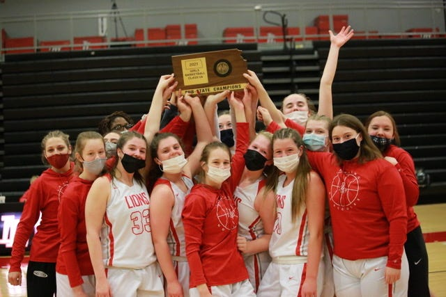 Shown is the Lansing women's basketball team following Friday's sub-state championship win against Piper. The victory clinched Lansing's third state tournament berth in women's basketball.