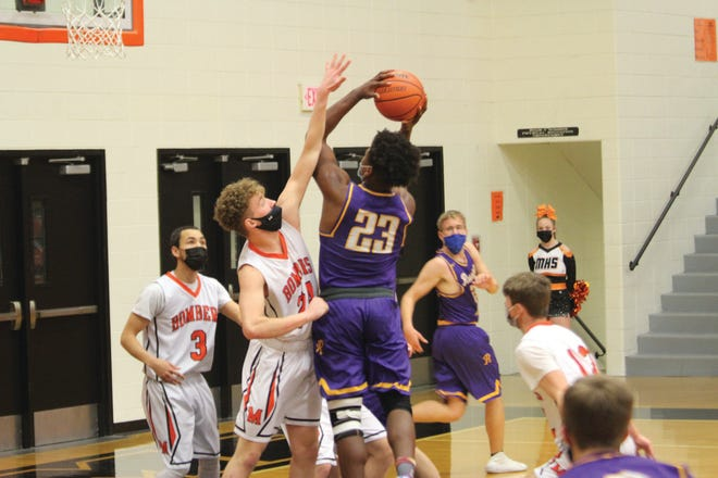 Macomb's Haden Case goes up to block a shot during Tuesday's game against Rushville-Industry.