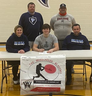 Connor McDonald, surrounded by parents Amy and Rick, Frankfort baseball coach Matt Miller, and Wheelhouse co-owner Shane Corwell, signed recently to play baseball at Bethany College.