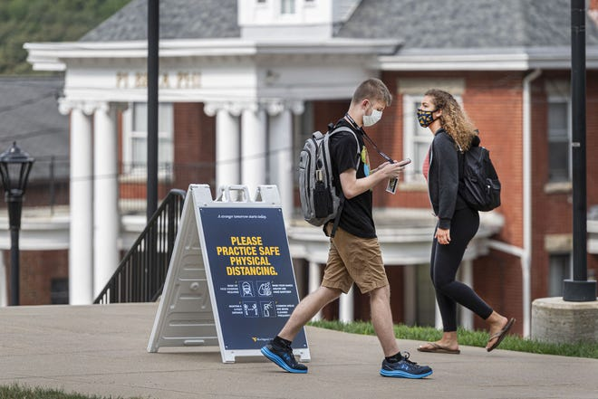 WVU Freshmen students' physical distance as students return to the WVU Campus for the first day of classes during the Covid-19 pandemic Aug. 26, 2020.