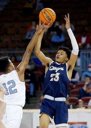 Heritage Hall's Trey Alexander shoots over Holland Hall's Jake Craft during a 53-51 overtime win Tuesday in a Class 4A boys high school basketball quarterfinal at State Fair Arena.