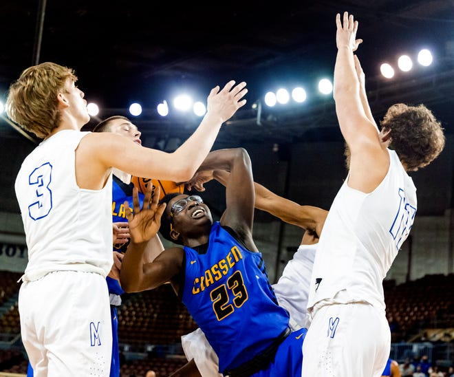 Mount St. Mary's Robert Kalsu (3) and Luke Harstad (11) defend on Classen's Anthony Turner (23) during the Class 4A Boys quarterfinal basketball game between Mount St. Mary and Classen SAS at the State Fair Arena in Oklahoma City, Okla on Wednesday, March 10, 2021. [Chris Landsberger/The Oklahoman]