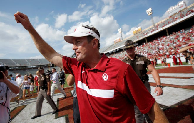 Oklahoma's Bob Stoops celebrates after the Red River Rivalry game against Texas at the Cotton Bowl in Dallas on Oct. 8, 2011.  Oklahoma won 55-17.