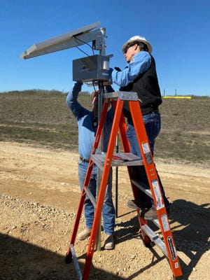 ConocoPhillips workers David Camille and Adrian Pena install a SOOFIE system at a company location. Submitted photo.