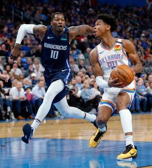 Thunder guard Shai Gilgeous-Alexander drives past Mavericks forward Dorian Finney-Smith. The Thunder and Mavericks will meet Thursday for the second time this season.