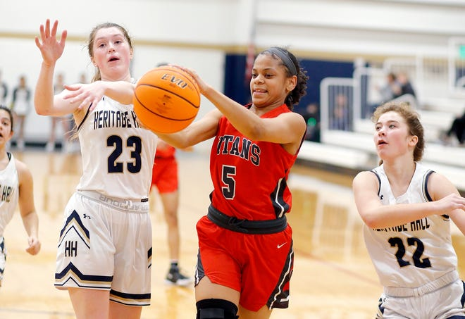 Carl Albert's Azya Poole tries to get a loose ball as Heritage Hall's Avery Freeman (23) and Lucille Sullivan (22) defend during the high school girls game between Heritage Hall and  Carl Albert at Heritage Hall in Oklahoma City, Friday, Jan. 17, 2020.