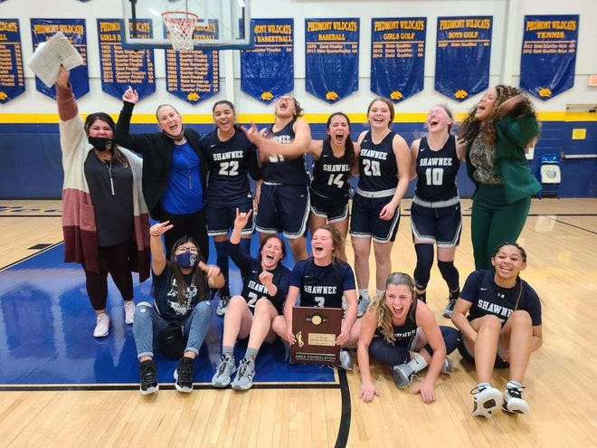 The Shawnee girls basketball team celebrates after a 50-48 win against Altus on Saturday to earn a trip to the Class 5A state tournament.