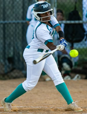 West Port's Aniyah Dixon hits a double in the first inning. The West Port Wolf Pack defeated the Vanguard Knights, 12-1, Tuesday night.