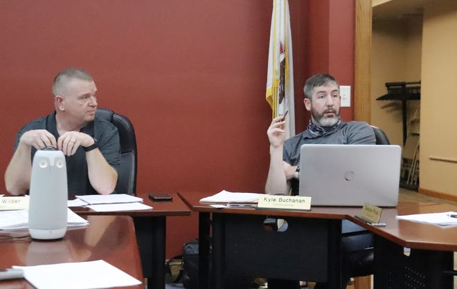 Chenoa Commissioner Kyle Buchanan, right, poses a question during public comment at Tueday's Chenoa City Council meeting. Looking on is Mayor Chris Wilder.