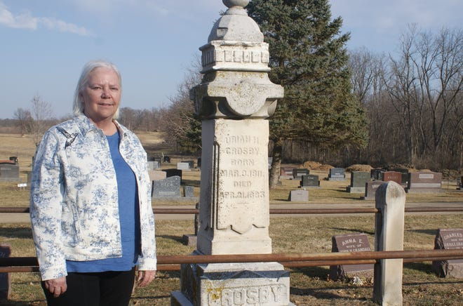 Pam Senkler of Naples, Fla., stands next to her great-great-grandfather Uriah Crosby's grave before a public recognition ceremony at Hirstein Cemetery in Morton. In addition to being one of Morton's earliest settlers, Crosby was one of 19 Tazewell County Underground Railroad conductors.
