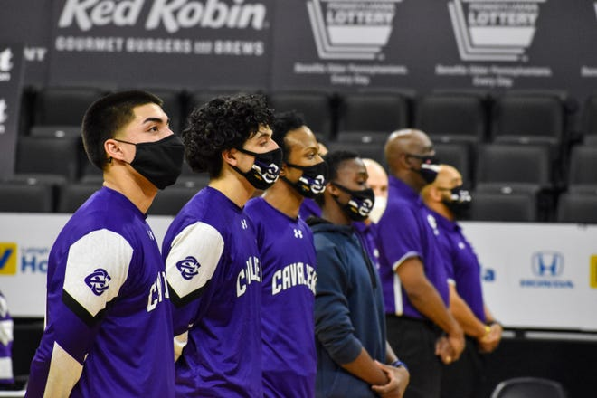 East Stroudsburg South boys basketball players stand in line for the national anthem prior to the District 11 Class 5A championship game against Bangor at the PPL Center in Allentown on Tuesday, March 9, 2021.