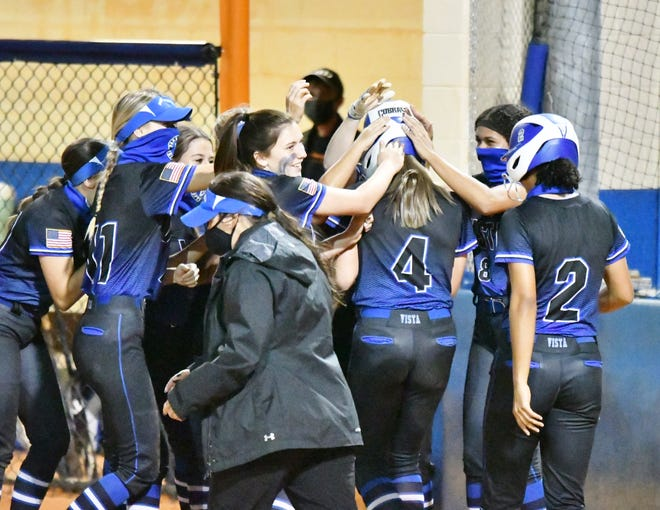 The Park Vista Cobras congratulate Illiana Hernandez following the junior's two-run home run to straightaway center-field in the top of the sixth inning. The Cobras defeated Palm Beach Gardens 10-1.