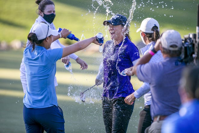 Austin Ernst gets a celebration bath from fellow LPGA pro Danielle Kang after winning the Drive On Championship Sunday in Ocala.
