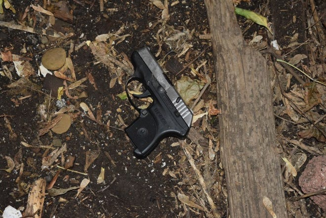Evidence photos document the Ruger 380 pistol used in King Pleasant's shooting death.
