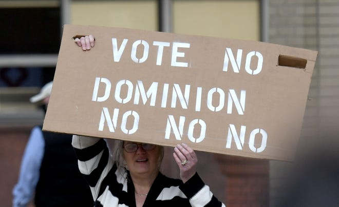 A group gathered last week to protest outside of Stark County Office Building demanding that Stark County not purchase new Dominion voting machines prior to the the Stark County commissioners vote on the matter. The Stark County Board of Elections now plans to sue.